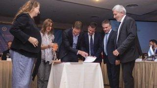 Santilli y Frederic firmaron un acuerdo
